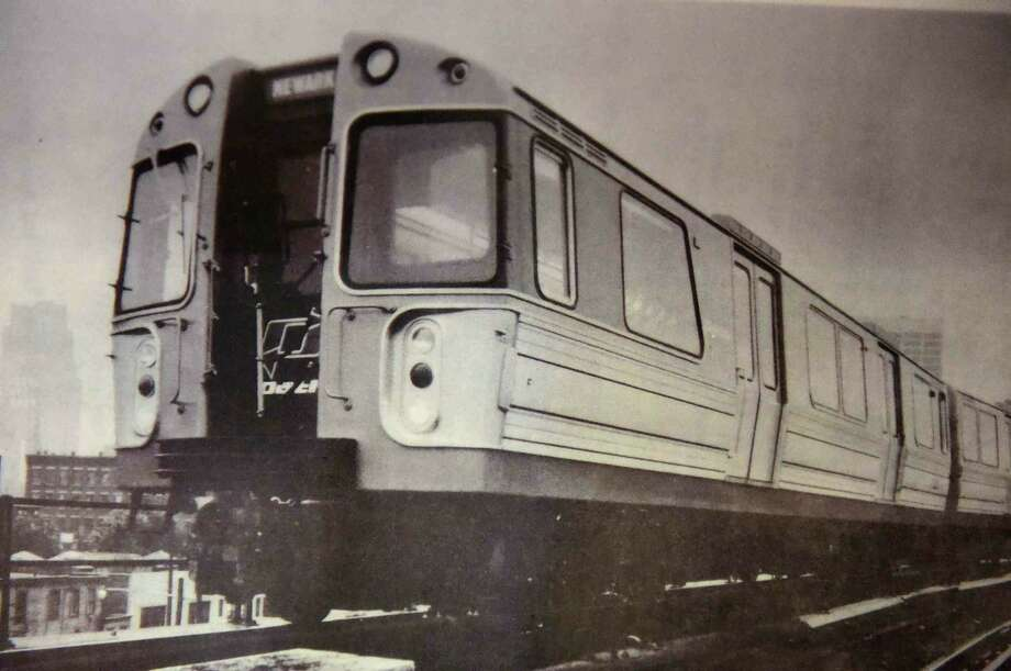 (Peter Hvizdak - New Haven Register) A photo of a model exactly like the PATH Car 745, which was in the PATH subway station under the North Tower of the World Trade Center and survived the 9/11 terrorist attack, has been restored at the Shore Line Trolley Museum in East Haven, Connecticut. The PATH Car 745 will be open to the public after a dedication ceremony Sunday, September 11, 2016 at the museum.The subway car, in the  permanent collection at the Shore Line Trolley Museum, is one of two that were found in a cast iron tunnel which enabled them to withstand the pressures from the collapsing World Trade Center building above. On the morning of September 11, 2001, the car was sent to the World Trade Center to pick up passengers, but none were found inside when the car was discovered during excavation. The Shore Line Trolley museum is the oldest operating trolley museum in the United States. See more photos at: photos.newhavenregister.com. Photo: Peter Hvizdak, ©2016 Peter Hvizdak / ©2016 Peter Hvizdak