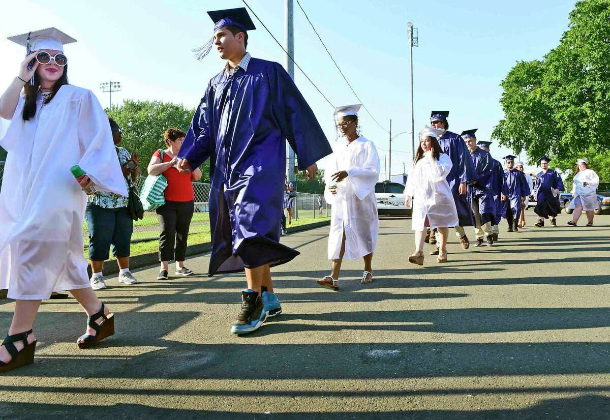 (Peter Hvizdak / Hearst Connecticut Media) Ansonia, Connecticut: June 12, 2017. The processional as the Ansonia High School Class of 2017 begins their commencement exercises at Jarvis Field in Ansonia Monday evening.