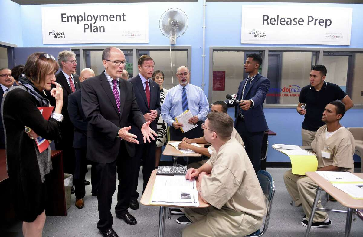 U.S. Secretary of Labor Thomas Perez (left) talks with Brian Gardner (foreground center) during a pre employment workshop for inmates at the New Haven Community Correctional Center on 9/19/2016. Photo by Arnold Gold/New Haven Register agold@newhavenregister.com