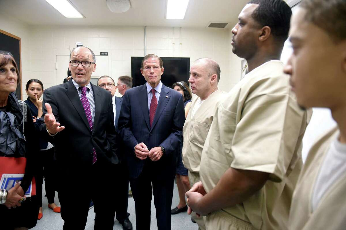 U.S. Secretary of Labor Thomas Perez joins other state and local politicians and officials to visit the New Haven Community Correctional Center meeting with inmates involved with job training programs on 9/19/2016. Photo by Arnold Gold/New Haven Register agold@newhavenregister.com