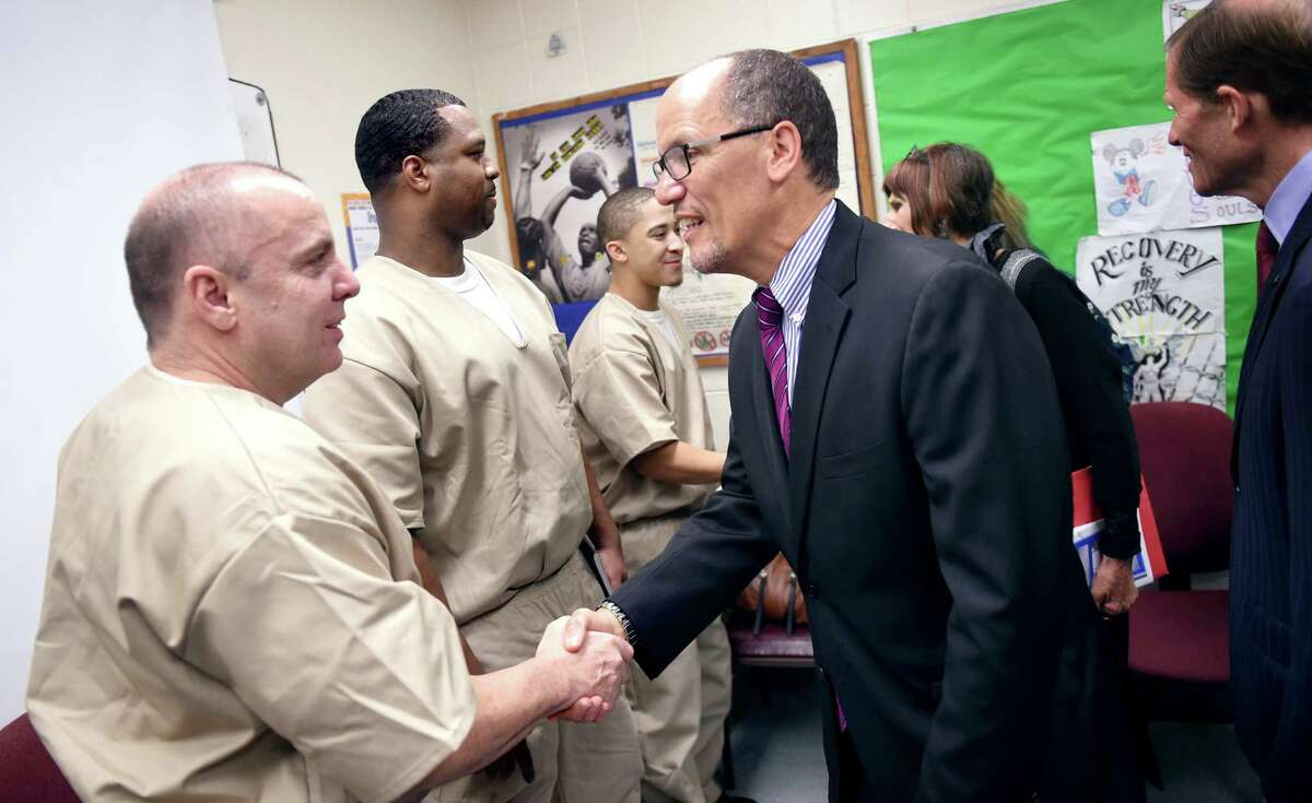Left to right, Liam Daley, Mathis McBride and Jose Rodriguez meet U.S. Secretary of Labor Thomas Perez at the New Haven Community Correctional Center on 9/19/2016. Daley, McBride and Rodriguez are participants in the Linking to Employment Pre-Release (LEAP) program. Photo by Arnold Gold/New Haven Register agold@newhavenregister.com