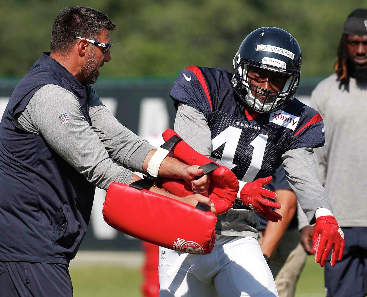 Houston Texans linebacker Zach Cunningham (41) fights past defensive coordinator Mike Vrabel during training camp at the Greenbrier on Wednesday, Aug. 2, 2017, in White Sulphur Springs, W.Va.