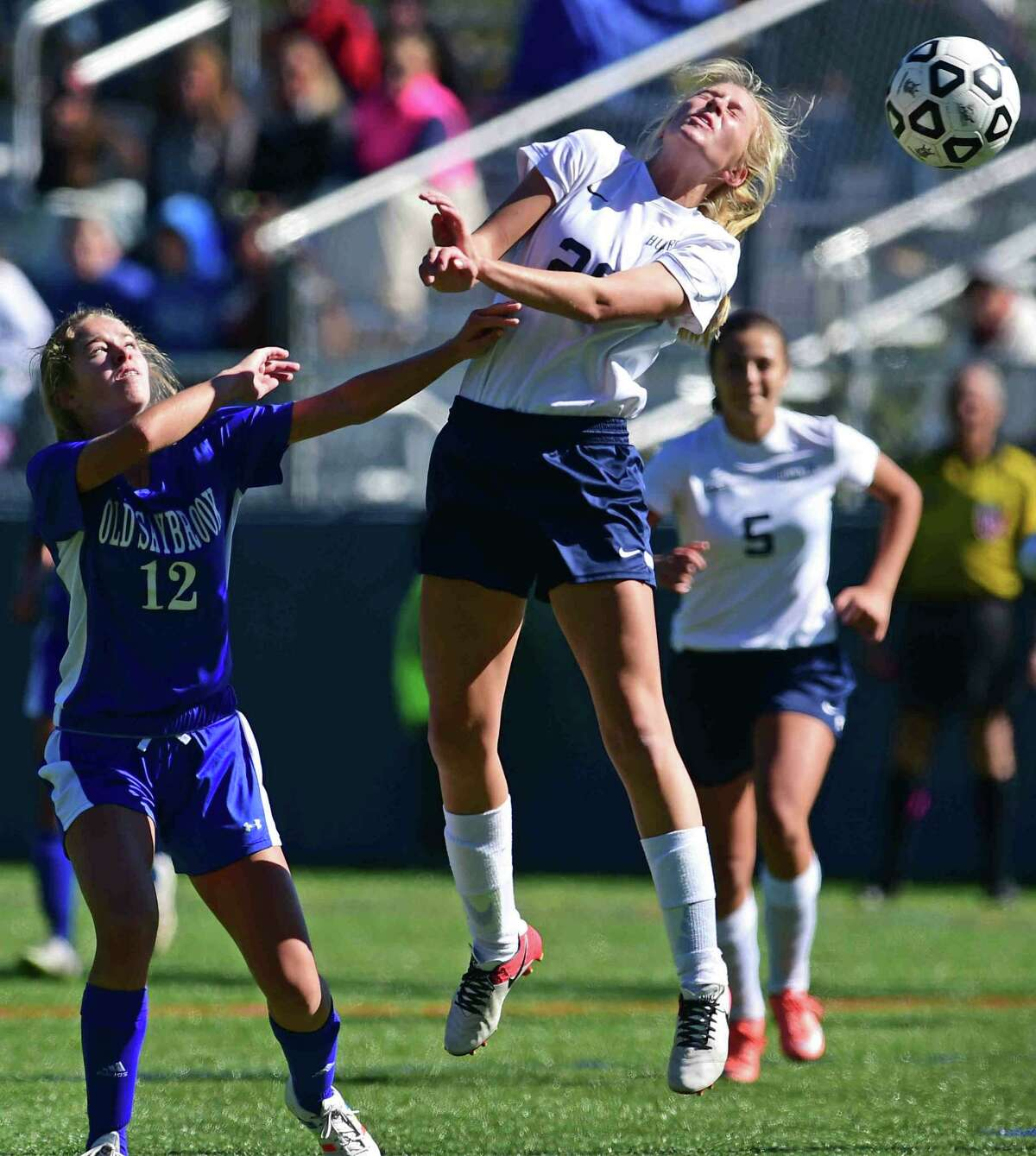 (Peter Hvizdak - New Haven Register) Jessica Stratton of Old Saybrook High School, left, covers Madison Emmi during first half girls soccer action Monday morning October 10, 2016 at the Indian River Recreational Complex in Clinton.