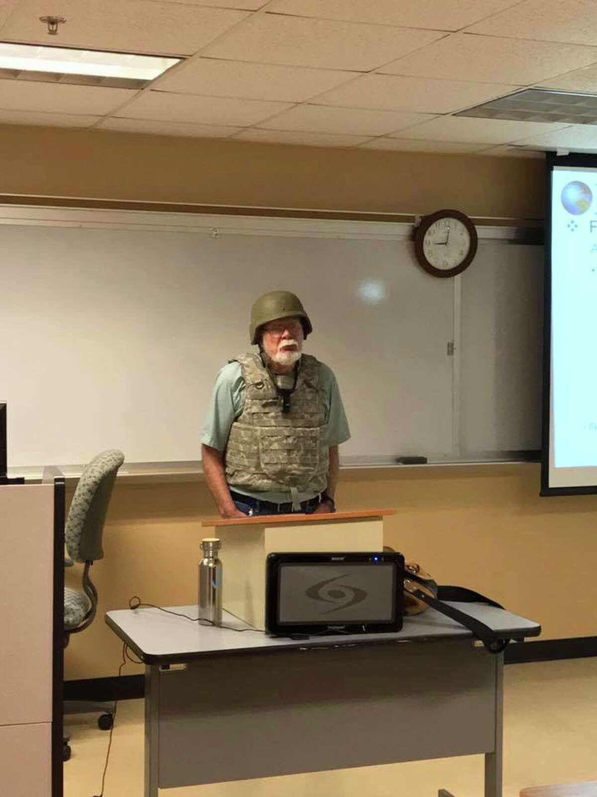 Geography instructor Charles K. Smith of San Antonio College wore protective gear in his class on Tuesday in response to the Campus Carry implementation in Alamo Colleges.