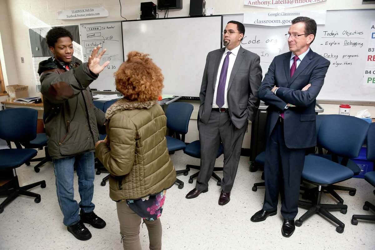 U.S. Secretary of Education John B. King, Jr., (center) and Governor Dannel Malloy (right) watch students in a focus group participate in a theatrical game concerning stress at Wilbur Cross High School in New Haven on 12/19/2016. Students in the Strong Program that meet after school invited other students to participate in a weekly focus group to better understand and combat stressors that effect high school performance. Photo by Arnold Gold/New Haven Register agold@newhavenregister.com