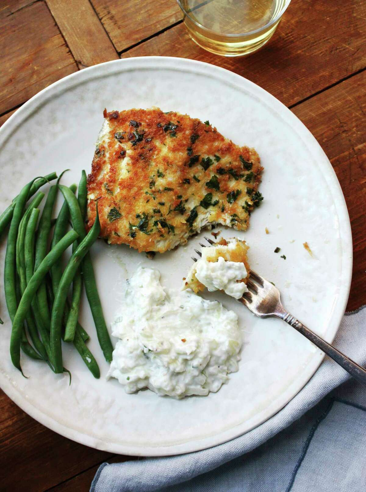 This December 2016 photo shows panko-crusted fish with tzatziki in New York. Tzatziki is one of the most classic Greek sauces, served with everything from pita (as a dip) to lamb to seafood. It?'s a refreshing mix of cucumber, garlic and yogurt. (Laura Agra via AP) ORG XMIT: NYLA202