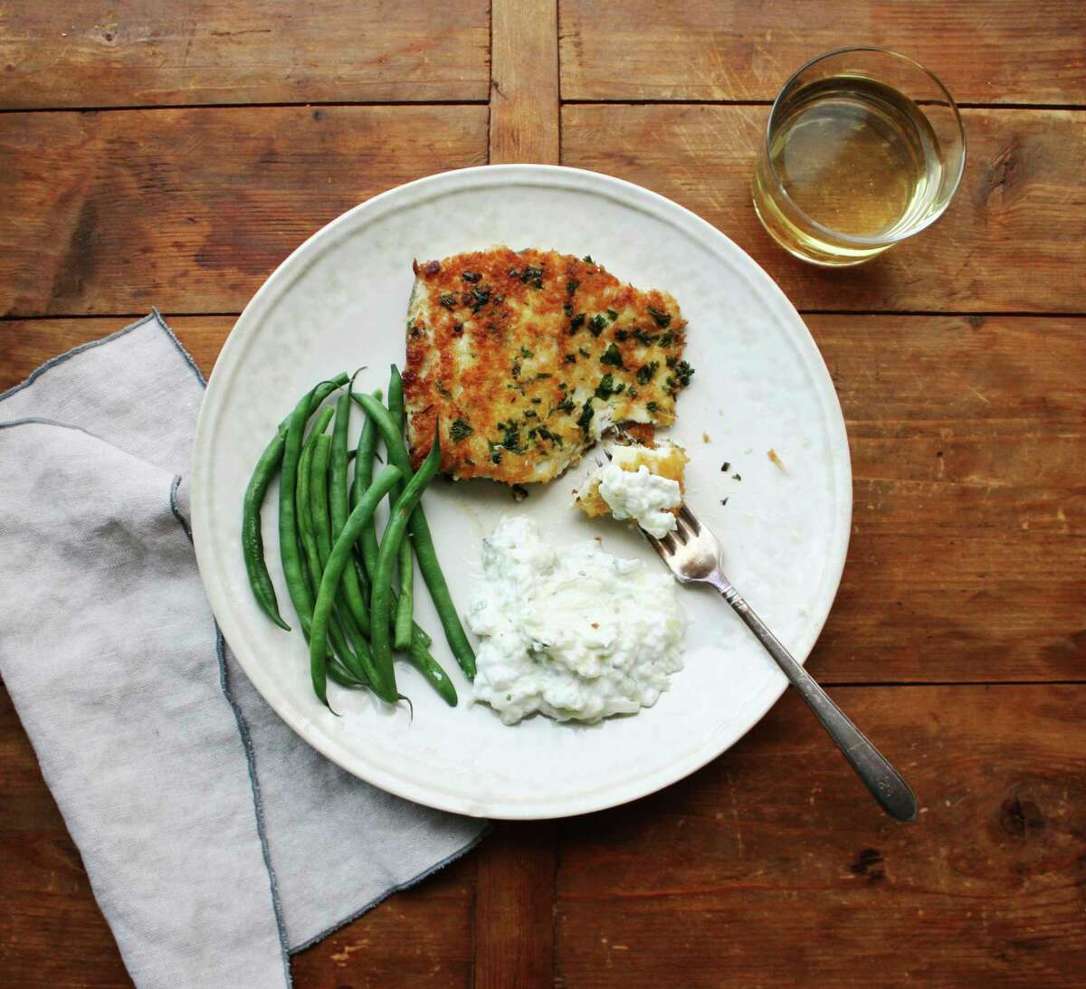 This December 2016 photo shows panko-crusted fish with tzatziki in New York. Tzatziki is one of the most classic Greek sauces, served with everything from pita (as a dip) to lamb to seafood. It?'s a refreshing mix of cucumber, garlic and yogurt. (Laura Agra via AP) ORG XMIT: NYLA201