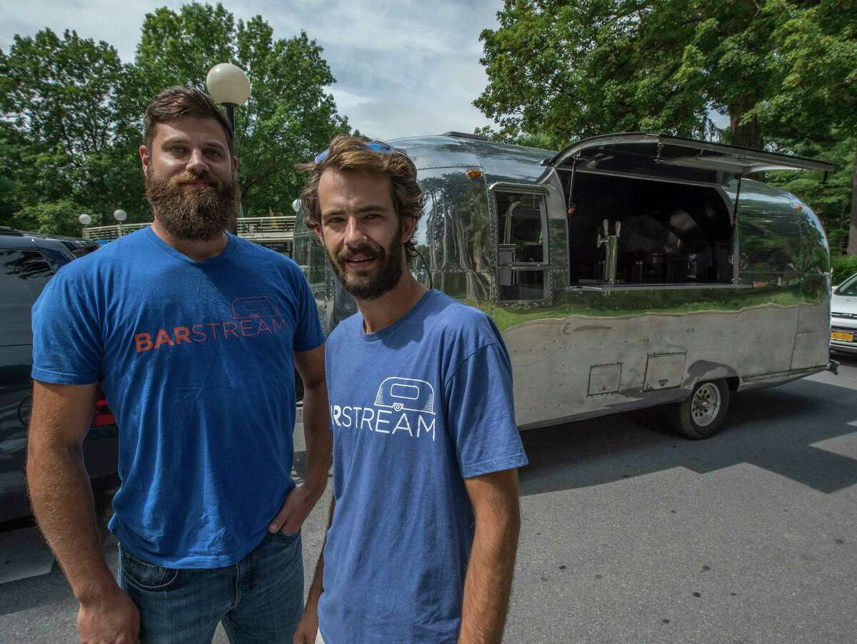 Ben Diedrich, left and Adam Lombard show off their BarStream rolling bar outside the Saratoga Performing Arts Center Thursday July 27, 2017 in Saratoga Springs, N.Y. (Skip Dickstein/Times Union)