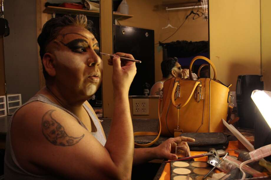 Tencha La Jefa has been doing drag for 20 years. She learned to do her makeup from other drag queens, and has enjoyed building her look to match the comedy of her character. Photo: By Alexis Will, San Antonio Express-News