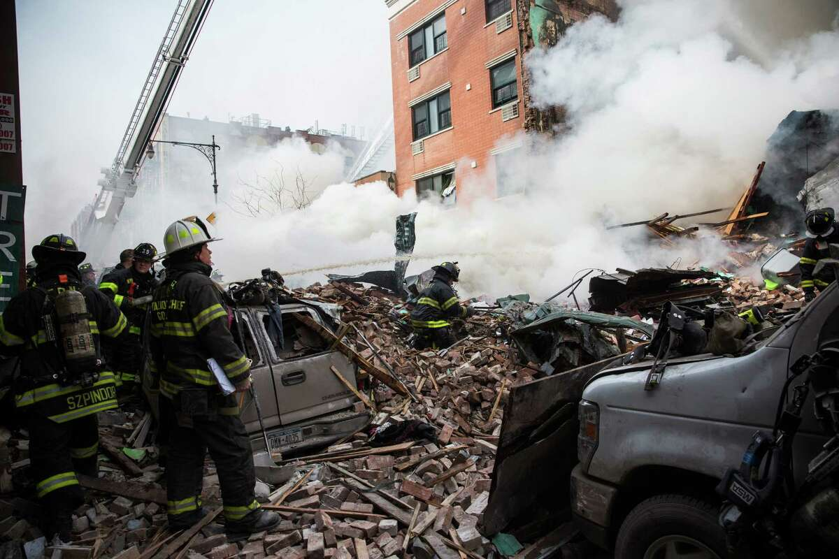 NEW YORK, NY - MARCH 12: Firefighters from the Fire Department of New York (FDNY) respond to a 5-alarm fire and building collapse at 1646 Park Ave in the Harlem neighborhood of Manhattan March 12, 2014 in New York City. Reports of an explosion were heard before the collapse of two multiple-dwelling buildings that left at least 11 injured.