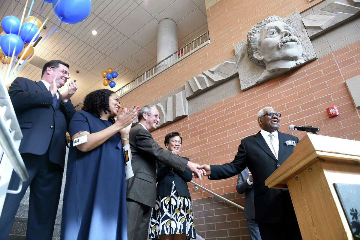 University of New Haven President Steve Kaplan (center) shakes the hand of New Haven Public Schools Superintendent Reginald Mayo (right) before the ribbon cutting ceremony in the lobby of the Engineering and Science University Magnet School in West Haven on 2/28/2017. Left to right are West Haven Mayor Ed O'Brien, ESUMS Principal Medria Blue-Ellis, University of New Haven President Steve Kaplan, New Haven Mayor Toni Harp and New Haven Public Schools Superintendent Reginald Mayo. Photo by Arnold Gold/New Haven Register agold@newhavenregister.com