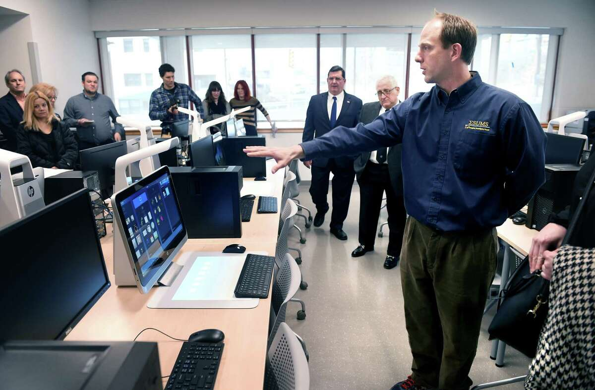 Math, Science and Engineering teacher Hunter Smith (right) gives a tour of the Architecture Lab at the newly opened Engineering and Science University Magnet School in West Haven on 2/28/2017. Photo by Arnold Gold/New Haven Register agold@newhavenregister.com
