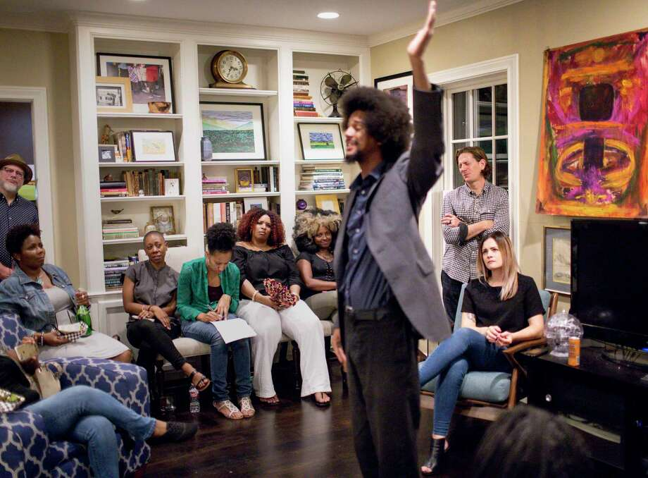 Matthew Russell, second from right, reacts as Jeremyah Payne performs a piece about race relations and code switching during a private event, Friday, May 26, 2017, in Houston. Photo: Jon Shapley, Houston Chronicle / © 2017 Houston Chronicle