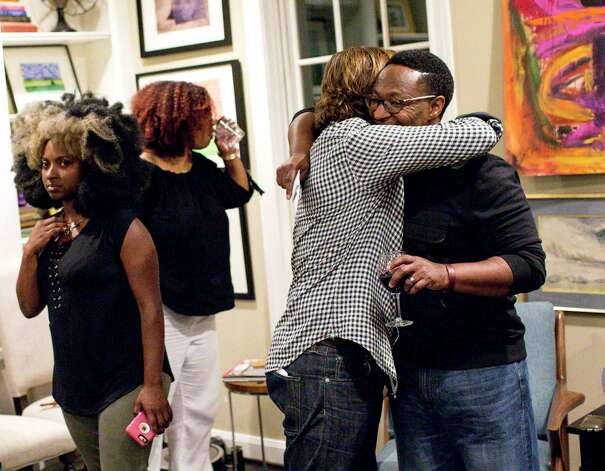 """Cleve Tinsley, right, hugs his friend Matthew Russell, after a private event the two put together to explore Houston's race relations. """"Truth is not a philosophical supposition,"""" Russell says. """"Truth is embedded in relationships, and relationships are not about what you can pin down, but what you can be exposed to."""" Photo: Jon Shapley, Houston Chronicle / © 2017 Houston Chronicle"""