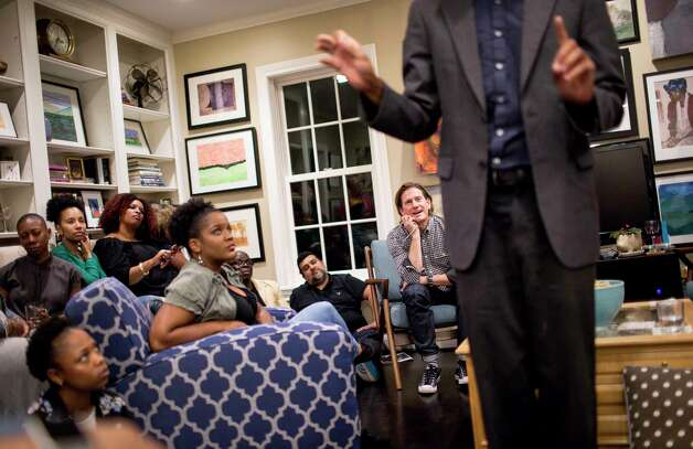 Matthew Russell, rear right, listens as Jeremyah Payne performs a poem about race relations and code switching. Russell prefers seats in the back of rooms, where he can listen to others as they take center stage. Photo: Jon Shapley, Houston Chronicle / © 2017 Houston Chronicle