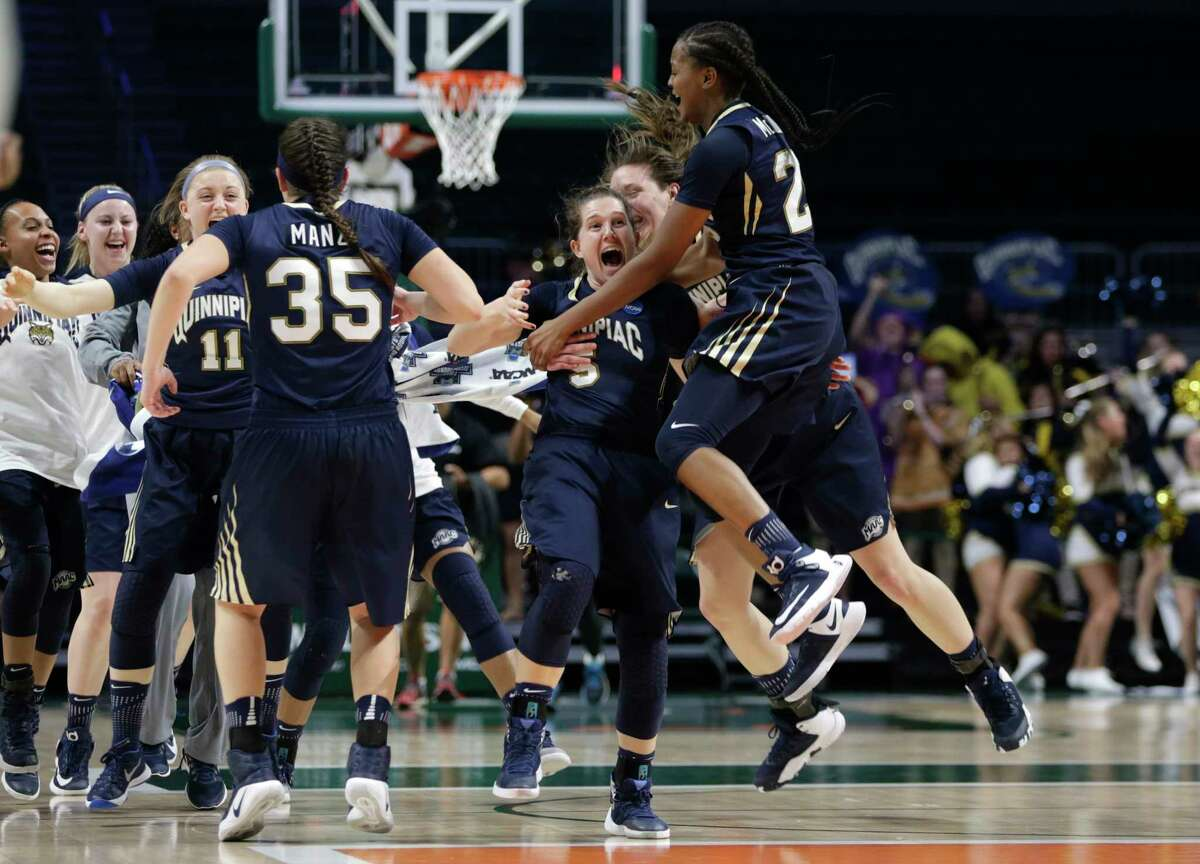 Quinnipiac's Carly Fabbri (5) celebrates with Morgan Manz (35) and Aryn McClure, right, after a second round game in the NCAA women's college basketball tournament against Miami, Monday, March 20, 2017, in Coral Gables, Fla. Quinnipiac won 85-78.