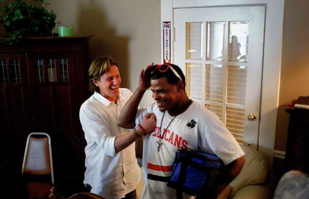 """Matthew Russell, left, jokes with Michael Franklin, right, after a meeting of """"We've Been There Done That,"""" where recovering drug users and sex workers attempt to rebuild their lives. In these meetings, Russell says, """"we're brought to a place of awe, of what people have had to carry."""" Photo: Jon Shapley, Houston Chronicle / © 2017 Houston Chronicle"""