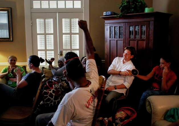 """""""I'm surrendered and I'm sober,"""" Matthew Russell, rear in white, says before passing a small mirror to the next person. At this meeting of """"We've Been There, Done That,"""" each person looks into the mirror and says something positive about themselves before passing it on. Photo: Jon Shapley, Houston Chronicle / © 2017 Houston Chronicle"""