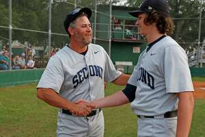 Houston head coach Lance Berkman congratulates starting pitcher Zach Heaton  after throwing a no-hitter. Berkman said that he instructs all of his pitchers to 'shut it down' for a minimum of three months every year, to minimize the risk of overuse and injury.