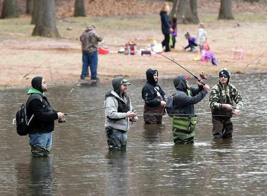 Fisherman wade into the lake at Wharton Brook State Park in Wallingford on the first day of trout fishing season on 4/8/2017.  Photo by Arnold Gold/New Haven Register  agold@newhavenregister.com