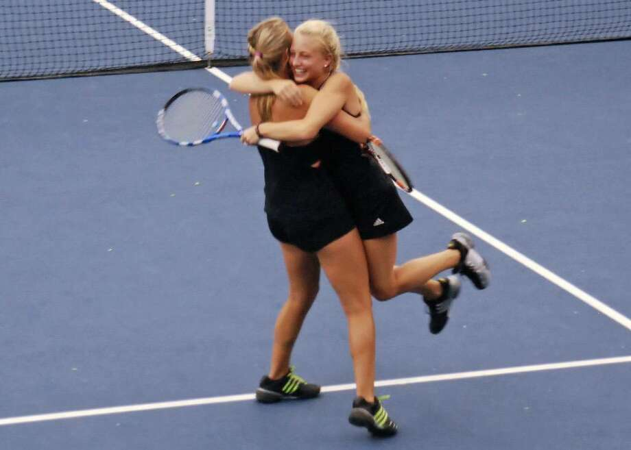 Weston senior captain Marie Gargiulo, left, and Emma Samson, celebrate its State Open doubles win on Wednesday. Photo: Contributed Photo / Steve Gersh