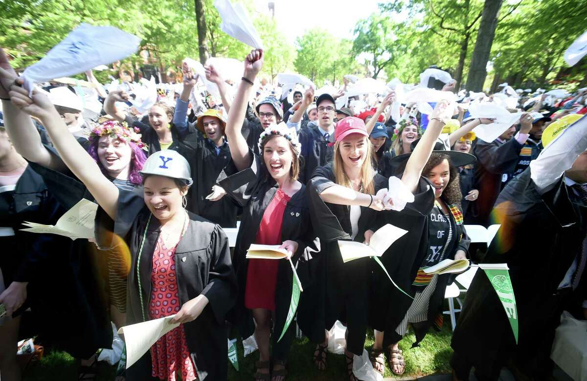 Students wave white handkerchiefs while singing the Yale University alma mater, Bright College Years, at the end of Class Day Exercises at Yale University's Old Campus in New Haven on 5/21/2017. Photo by Arnold Gold/New Haven Register agold@newhavenregister.com