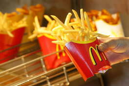 Munich, GERMANY: A McDonald?s employee makes French fries at a McDonald?s restaurant beside their headquarters in Munich, southern Germany 27 February 2007. Bane Knezevic (not in picture), president of the western division of McDonald's Europe and chairman of McDonald's Germany reported at a press conference that Mcdonald's turnover had increased by 6,2 percent in 2006. AFP PHOTO DDP/JOERG KOCH GERMANY OUT (Photo credit should read JOERG KOCH/AFP/Getty Images)
