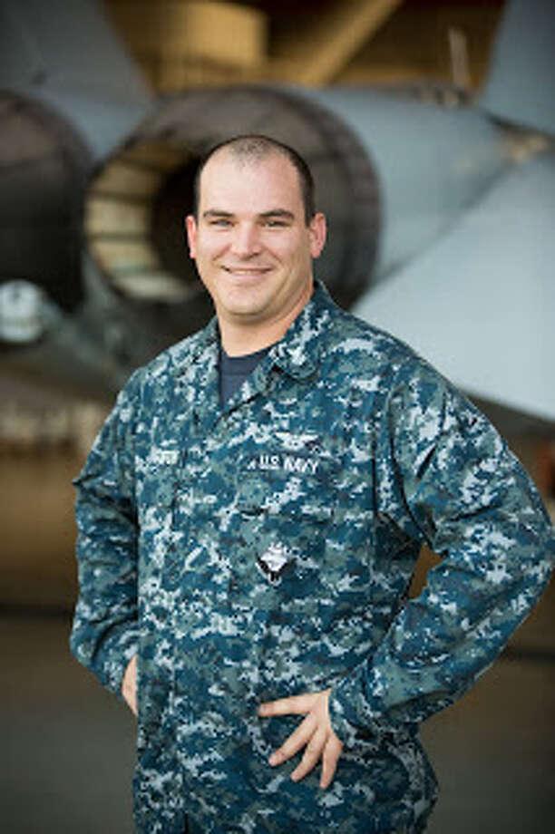 "Petty Officer 1st Class Dustin Livingston is an aviation ordnanceman with the ""Top Gun"" Naval Aviation Warfare Development Center in Fallon, Nevada. Photo: Navy Office Of Community Outreach"