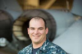 "Petty Officer 1st Class Dustin Livingston is an aviation ordnanceman with the ""Top Gun"" Naval Aviation Warfare Development Center in Fallon, Nevada."
