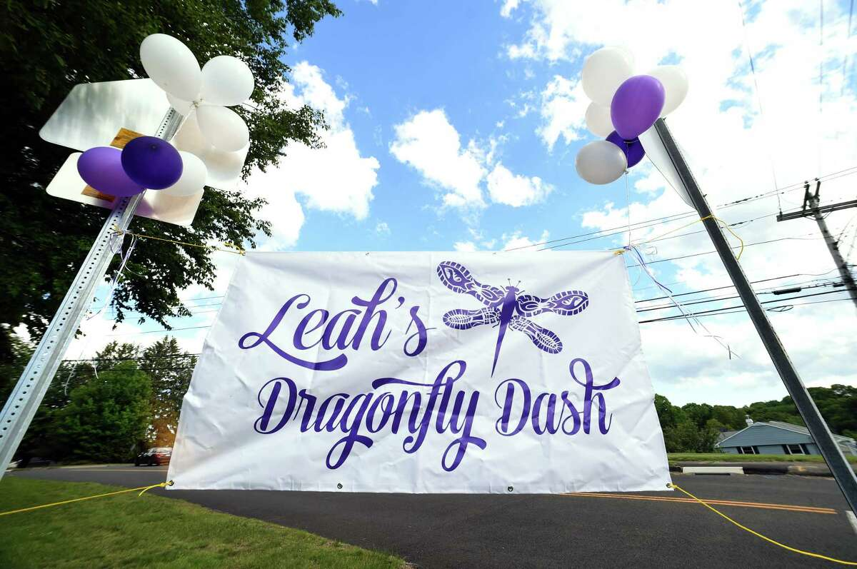 A sign is displayed near the start and finish of Leah's Dragonfly Dash, a 3.1 mile race walk honoring Leah Rondon, in front of Mead School in Ansonia on 6/2/2017. Rondon died after being hit by a car in 2015. Photo by Arnold Gold/New Haven Register agold@newhavenregister.com