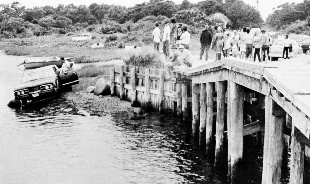 Sen. Edward Kennedys car is pulled from water as the car is screened off the bridge at Edgartown, July 19, 1969, Edgartown, Mass. The body of Mary Kopechne of Washington, D.C., was found in rear seat. Her death was attributed to drowning. (AP Photo)