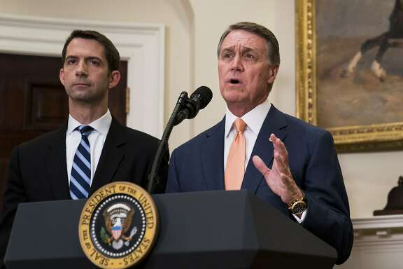 Sens. Tom Cotton (R-Ark.) and David Perdue (R-Ga.) deliver a statement after President Donald Trump announced proposed immigration legislation at the White House, in Washington, Aug. 2, 2017. The Raise Act, sponsored by Cotton and Perdue would overhaul decades of immigration policy by replacing a system that favors family ties in deciding who can move to the United States legally with merit-based preferences based on skills and employability. (Doug Mills/The New York Times)