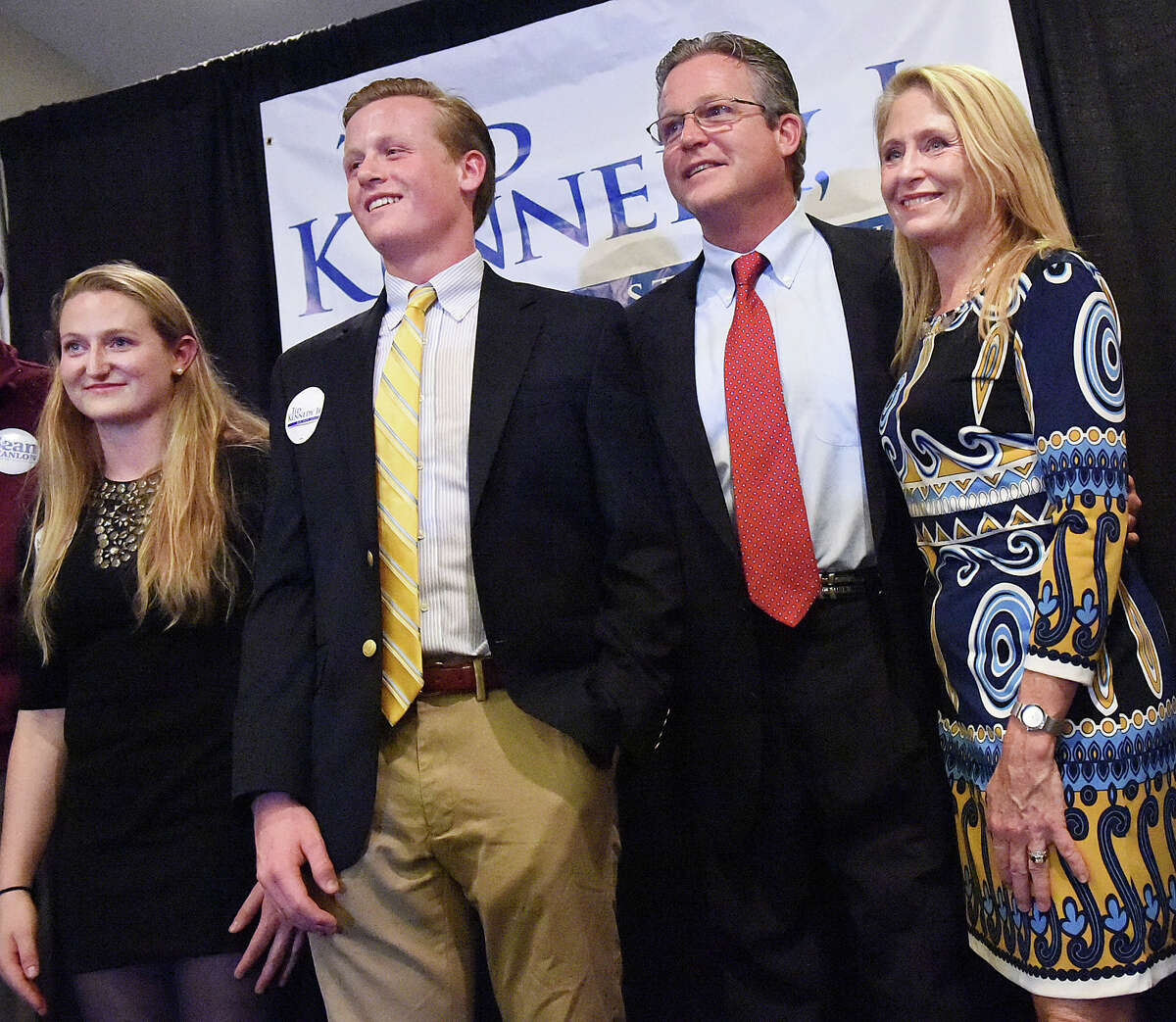 """(Catherine Avalone - New Haven Register) Democrat Ted Kennedy, Jr. and his wife, Dr. Katherine """"Kiki"""" Kennedy and their children Kiley and Edward at the Italian American Club of Branford on Election Day, Tuesday, November 4, 2014."""