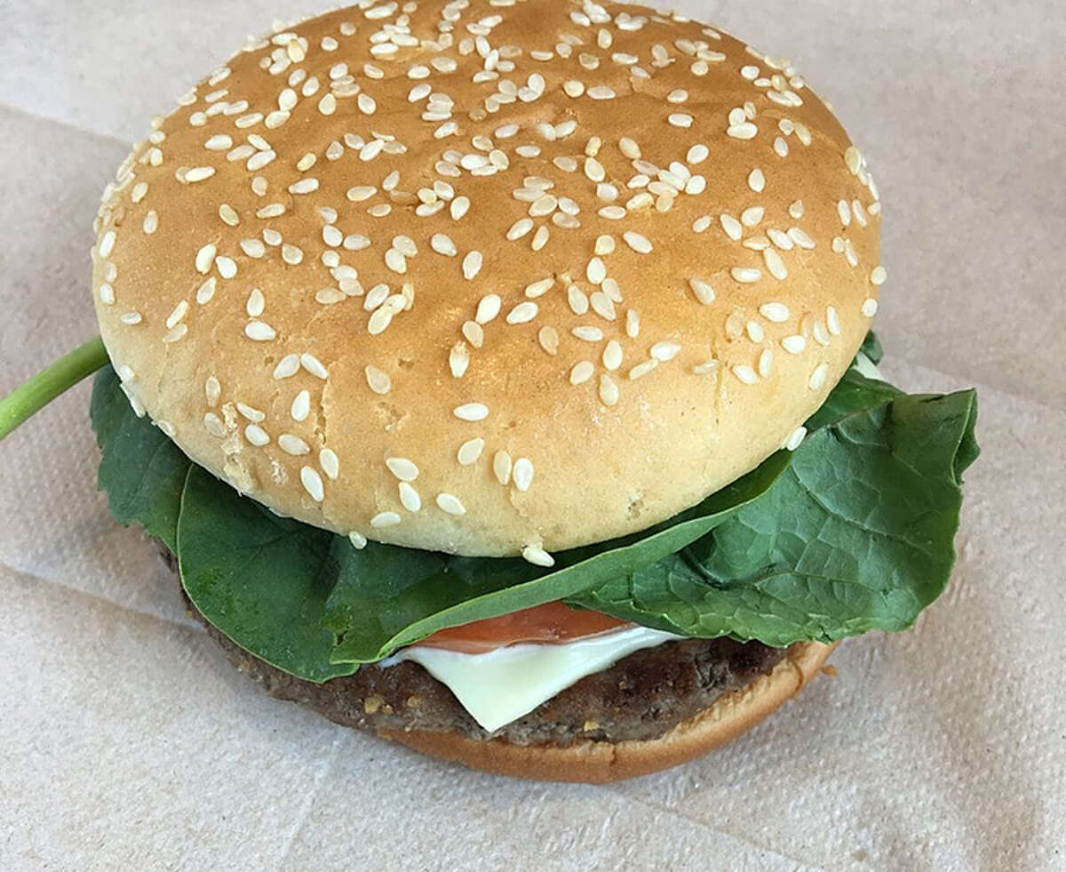 The new Sriracha Mac sauce from McDonald's can be applied to a quarter-pound burger (above), grilled chicken or fried chicken.