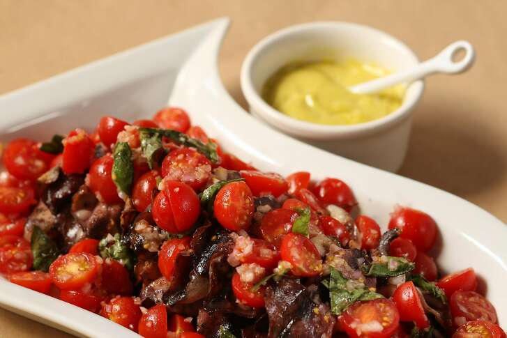 Grilled calamari and tomatoes in San Francisco, Calif., on August 28, 2008