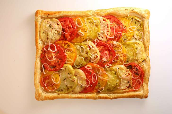 MUSTARD20_067_cl.JPG Food story on mustard. Craig Lee / The Chronicle Ran on: 10-18-2006 A delicate puff pastry crust is brushed with whole-grain mustard and topped with late-season tomatoes, fresh thyme and slivered shallots. Then it's baked until the tomatoes have softened.
