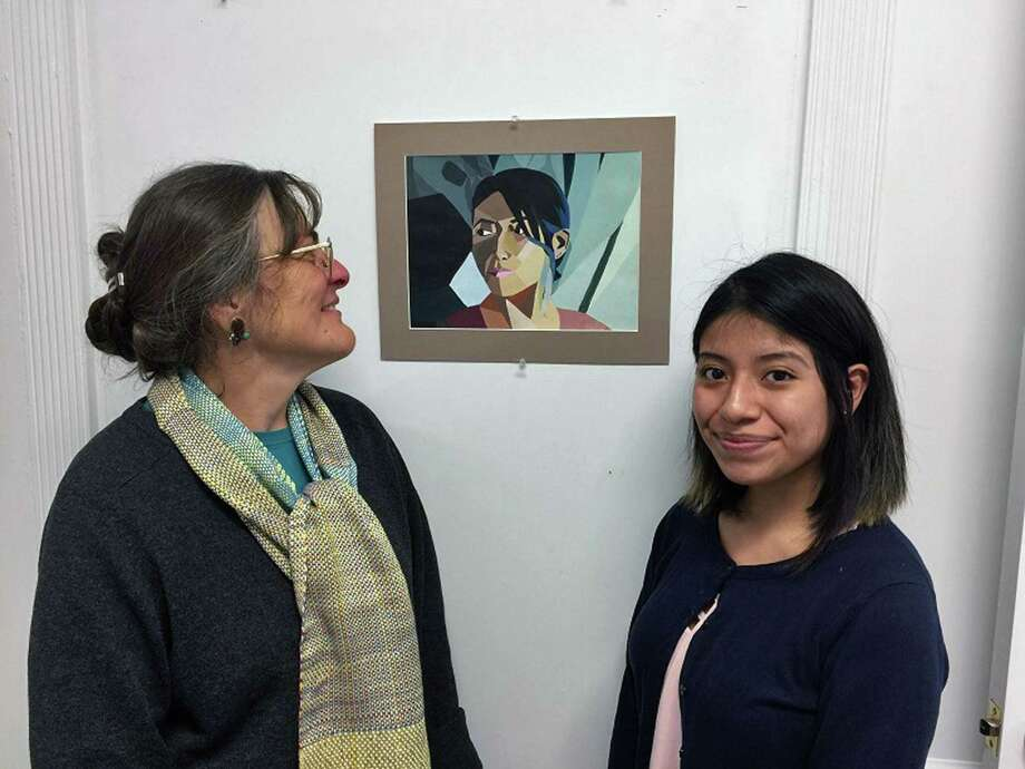 Maritza Quintuna, 21, of Bridgeport, (right) received an Art WorkForce Initiative Internship with the Connecticut Office of the Arts (COA). She will complete her internship at the City Lights Gallery under the guidance of the gallery's Executive Director Suzanne Kachmar (left). The two are pictured with Quintuna's work above. Photo: Contributed Photo / City Lights Gallery / Contributed Photo / Connecticut Post Contributed