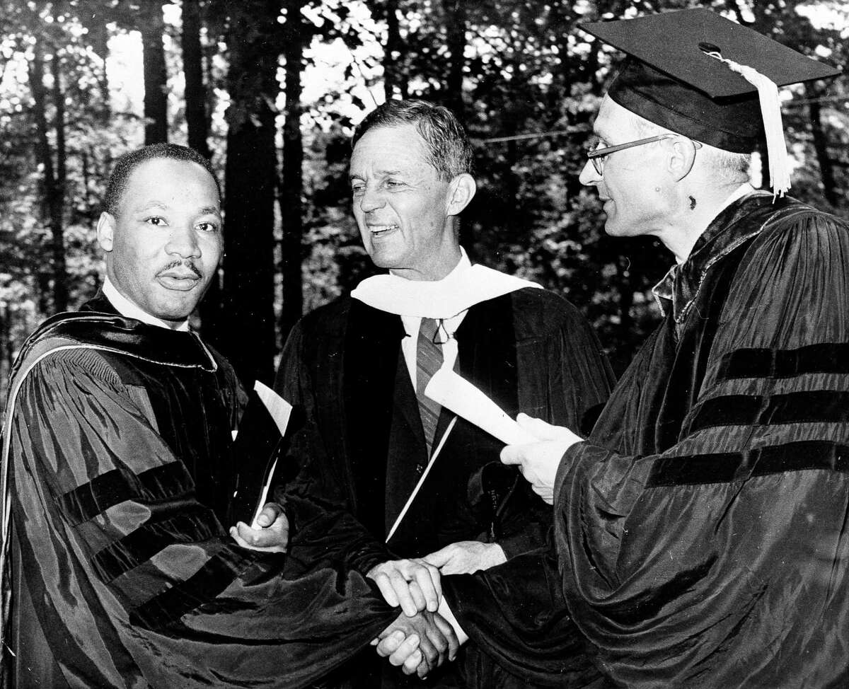 U.S. Sen. Joseph Clark (D-Pa.), center, laughs along with Dr. Martin Luther King, left, leader against segregation, at Lincoln University commencement exercises, June 7, 1961, Oxford, Pa. At right is acting President Donald Yelton. (AP Photo/Sam Myers)