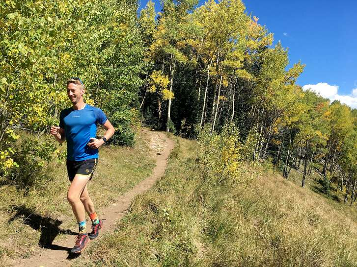 Runner Peter Koch finds his rhythm through the aspens on a long run at Doctor Park, south of Crested Butte, Colo.