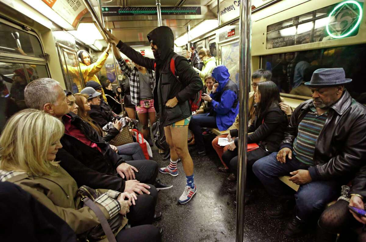 Several men in underwear ride a downtown 6 train in Manhattan during the 15th annual No Pants Subway Ride Sunday, Jan. 10, 2016, in New York. The group event, a prank meant to amuse unsuspecting subway riders, has been going on since 2002.
