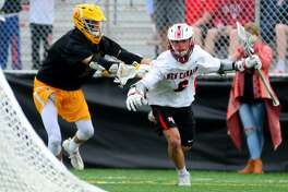 New Canaan's Jackson Appelt drives towards the goal from behind as Brunswick's Xander Dickson blocks during boys lacrosse action between New Canaan and Brunswick in New Canaan, Conn., on Saturday Apr. 15, 2017.
