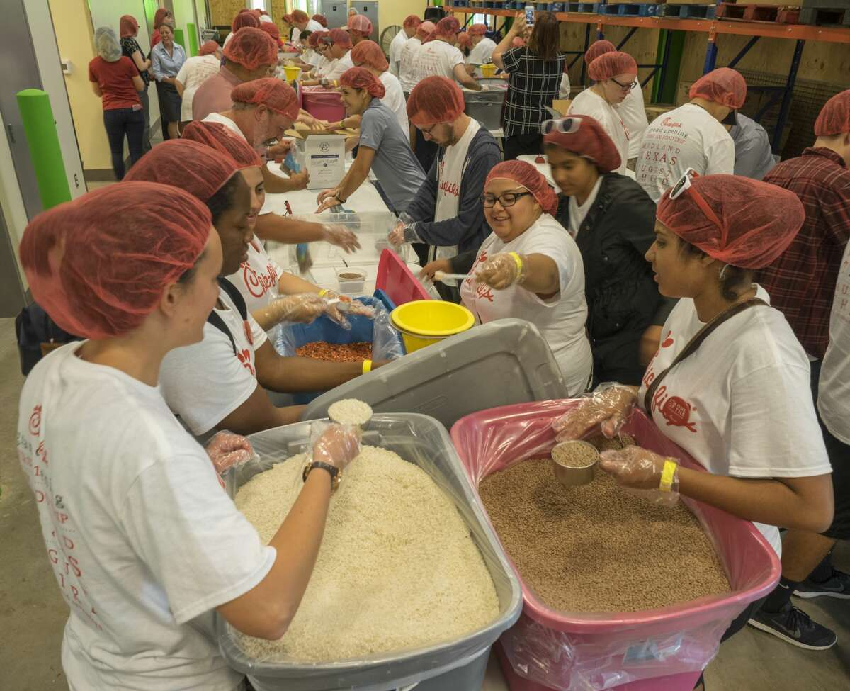 The Chick-Fil-A tour 8/02/17 included a stop at the West Texas Food Bank to fill 10,000 meals for Feed Children Everywhere. Tim Fischer/Reporter-Telegram