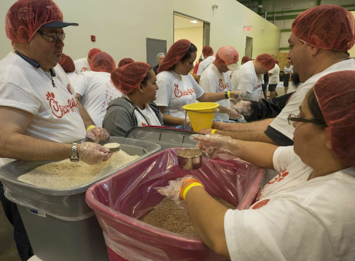 The Chick-Fil-A tour 8/02/17 included a stop at the West Texas Food Bank to fill 10,000 meals for Feed Children Everywhere. Pre-measured and seasoned packages of Lentil Casserole are prepared and sealed before being placed in boxes for shipping. Tim Fischer/Reporter-Telegram