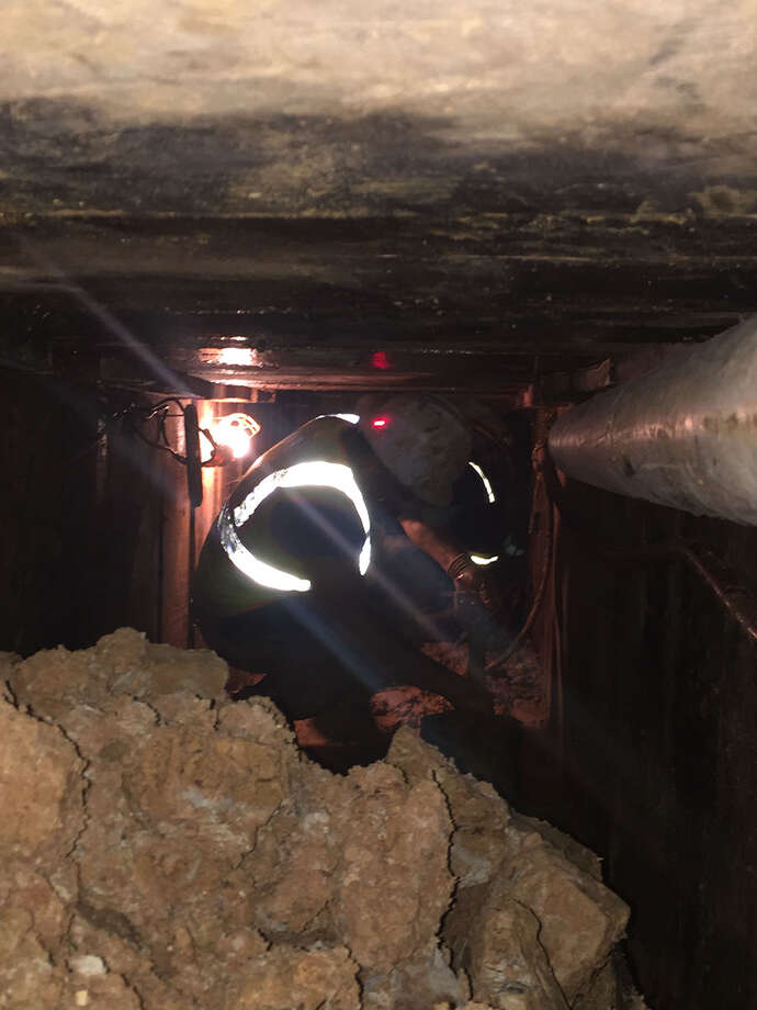 When dense underground utilities preclude use of heavy machines, specialty workers have to spend hours in the hole excavating a tunnel by hand. Photo: P&Z Logistics