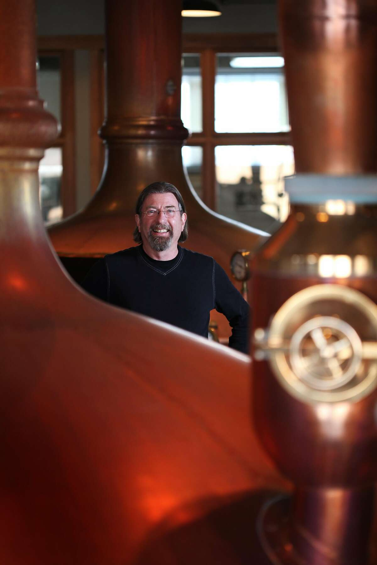 Keith Greggor, President & CEO of Anchor Brewers & Distillers, poses for portraits among brew kettles at the company's Potrero Hill headquarters on March 5, 2013 in San Francisco, Calif.