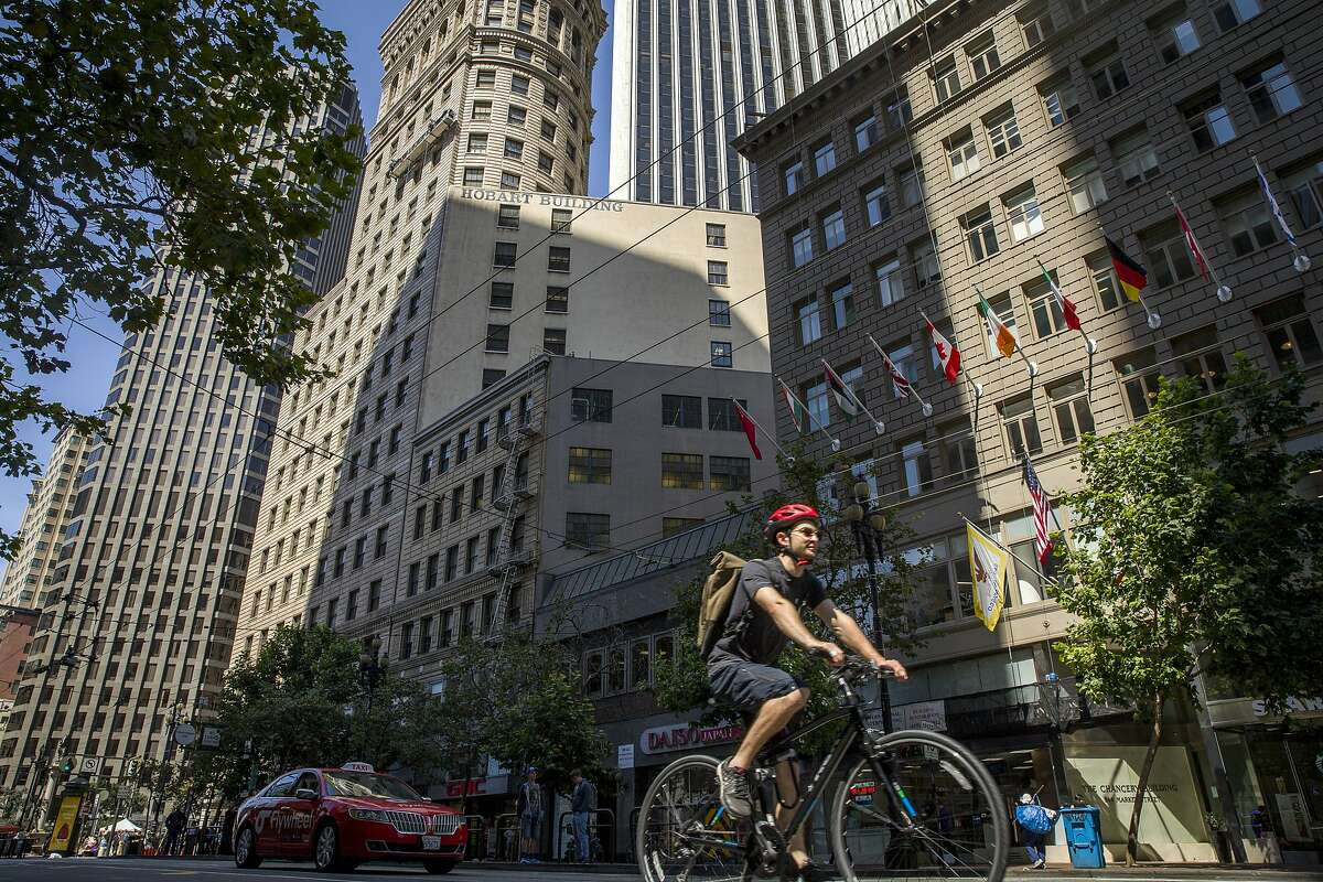 Bicycles and cars are likely to share Market Street for the forseeable future