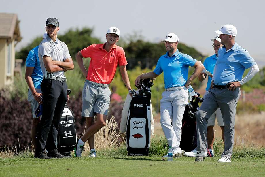 Golden State Warriors basketball star Stephen Curry, (left) on Tues. August 1, 2017, with his group waiting to tee off, with (l tor ) his caddie Jonnie West, (behind) caddie Jason Thomas, player Taylor Moore, caddie Jason Kuo and player Nick Rousey, during a practice round for the Ellie Mae Classic at TPC Stonebrae, in Hayward, Ca. Curry is making his professional golf debut as he prepares to compete in his first Web.com Tour event. Photo: Michael Macor, The Chronicle