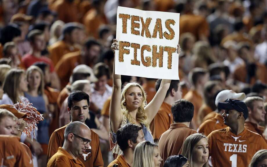A Texas Longhorns fan holds a sign during the game with the Rice Owls Sept. 12, 2015, at Texas Memorial Stadium in Austin. Texas won 42-28. Seeing a college sporting event can be one way to enjoy a college town vacation. Photo: Edward A. Ornelas /San Antonio Express-News / © 2015 San Antonio Express-News