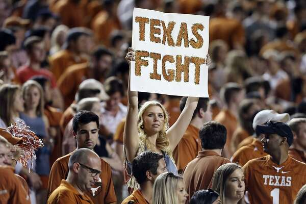 A Texas Longhorns fan holds a sign during the game with the Rice Owls Sept. 12, 2015, at Texas Memorial Stadium in Austin. Texas won 42-28. Seeing a college sporting event can be one way to enjoy a college town vacation.