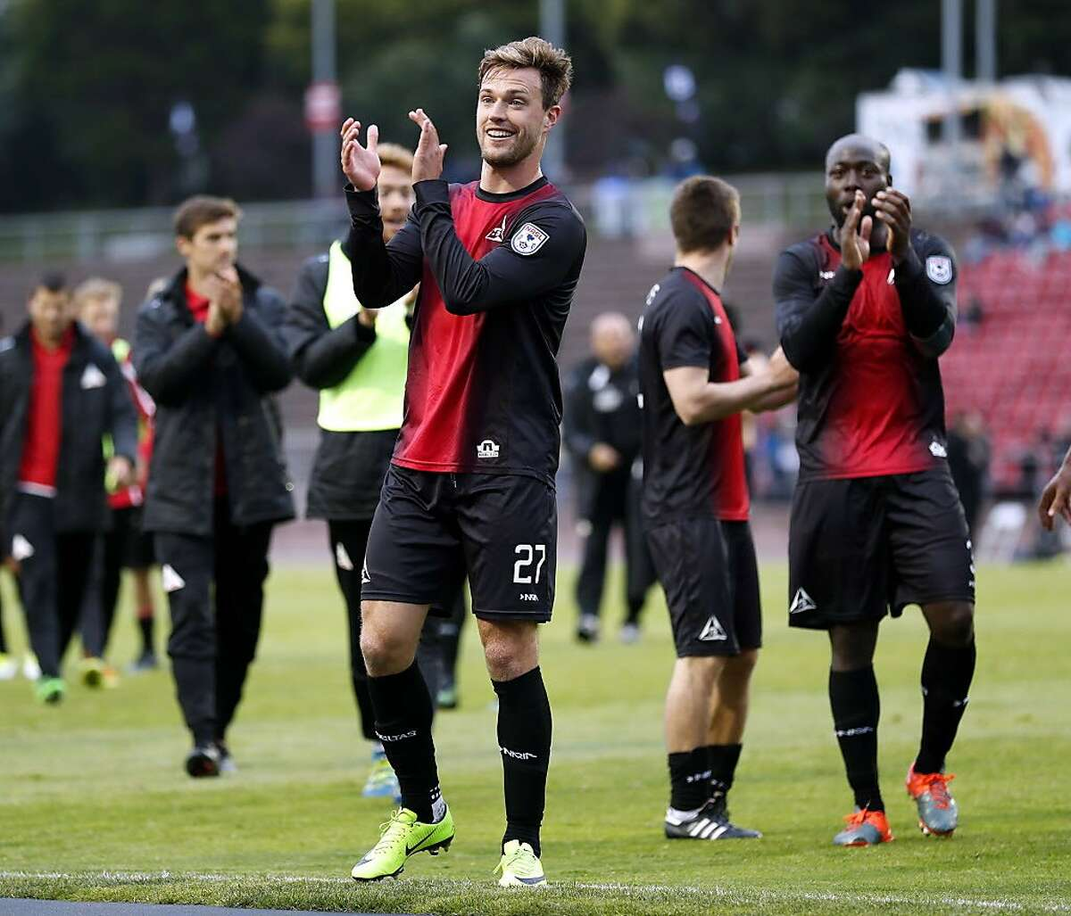 San Francisco Deltas' Andrew Lubahn (center) and Nana Attakora (right) applaud fans after the Deltas' 2-0 win over Puerto Rico at Kezar Stadium in San Francisco, Calif., on Sunday, July 2, 2017.